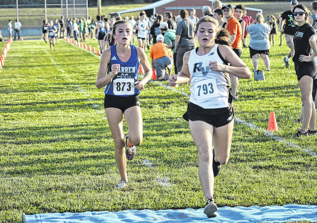 River Valley's Lauren Twyman crosses the finish line at the Federal Hocking Invitational on Sep. 19 in Stewart, Ohio.