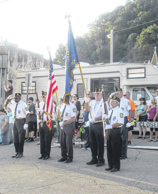 The American Legion conducted the flag raising during the opening ceremony on Thursday evening.