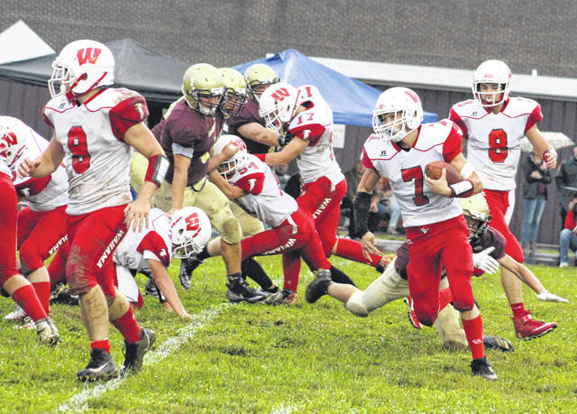 Wahama senior Tanner Smith (7) follows his blocking during a first quarter run on Monday night in a Week 5 TVC Hocking football contest against Federal Hocking in Stewart, Ohio.
