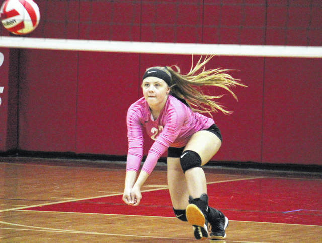 Wahama libero Bailee Bumgarner receives a serve, during the Lady Falcons' loss to Miller on Tuesday at Gary Clark Court in Mason, W.Va.
