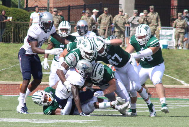 Members of the Ohio defense, led by Kylan Nelson (bottom), swarm Howard's Khalid Dorsey, during the 2018 season opener at Peden Stadium in Athens, Ohio. (Alex Hawley|OVP Sports)