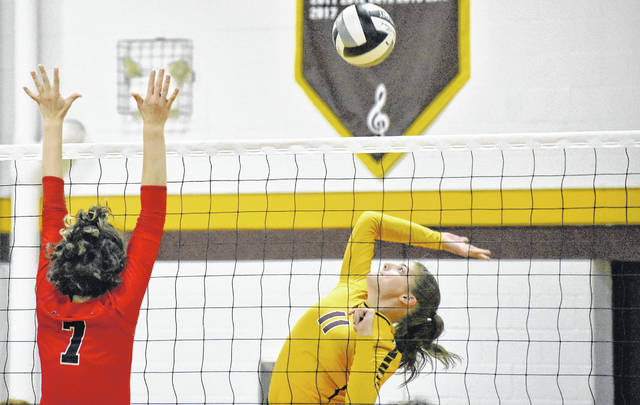 MHS sophomore Hannah Durst (11) attempts a spike during the Lady Marauders setback against Alexander on Tuesday night in Rocksprings, Ohio.