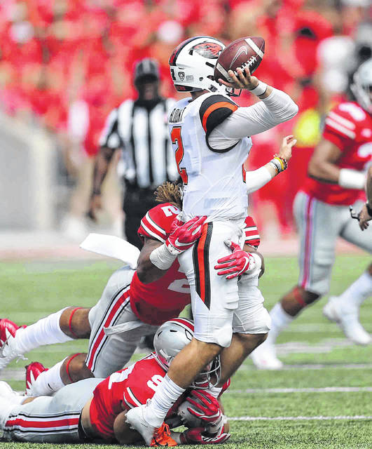 Ohio State's Chase Young (2) and Nick Bosa (97) apply pressure to Oregon State quarterback Conor Blount during a Week 1 football contest at Ohio Stadium in Columbus, Ohio.