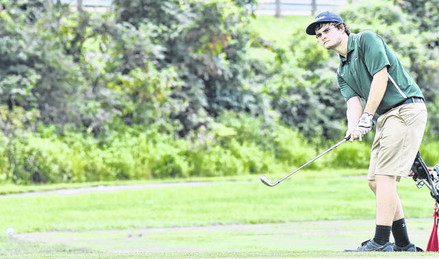 EHS senior Ryan Harbour attempts a put during a match on August 7 at Cliffside Golf Course in Gallipolis, Ohio.