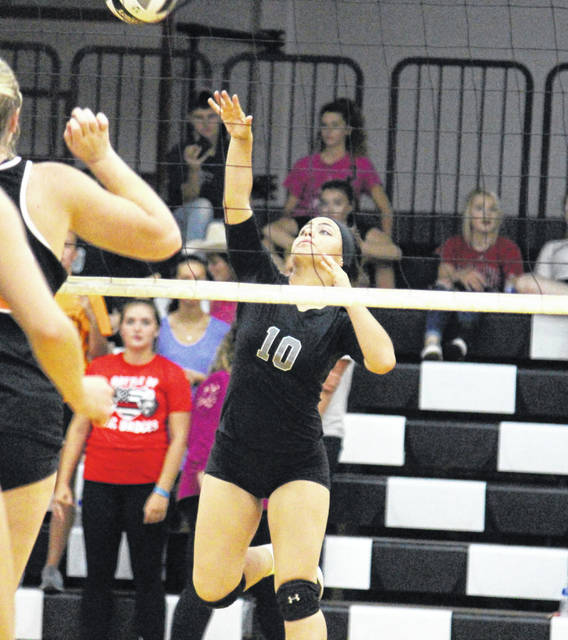 River Valley senior Cierra Roberts (10) gets a back row kill, during the Lady Raiders' loss to Nelsonville-York on Thursday in Bidwell, Ohio.