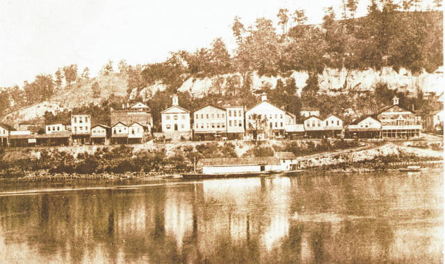A view from the river in this 1870 photo of downtown Pomeroy shows the buildings along Main Street and Second Street, including the Meigs County Courthouse before the extensions were added on the sides. Also visible is the river front area with a boat docked along the shore.