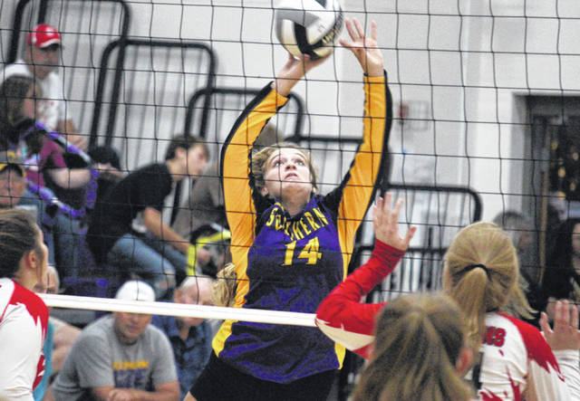 Southern senior Abby Cummins (14) tips the ball over the net, during the Lady Tornadoes victory on Tuesday in Racine, Ohio.