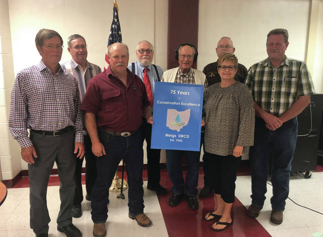 Past and current supervisors of the Meigs Soil and Water Conservation District were recognized Oct. 2 at the district's annual meeting and banquet, which also marked the 75th anniversary of the district. Shown are, from left: Bill Baer (2002-present), Charles Yost (1991-1999), Keith Bentz (2015-present), David Gloeckner (1975-1992), Don Mora (1952-1958), Ron Eastman (1988-1990), Tonja Hunter (2006-present), Tony Carnahan (2016-present). Also present that evening but not photographed were Rex Shenefield (1960-1987, 1991), Tom Theiss (1979-2002), Alan Holter (1983-1991), Joe Bolin (1992-present), and Kim Romine (2010-2015).