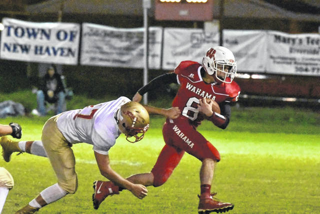 Wahama quarterback Abrahm Pauley (8) eludes a South Gallia defender during Friday night's Week 8 TVC Hocking contest at Bachtel Stadium in Mason, W.Va.