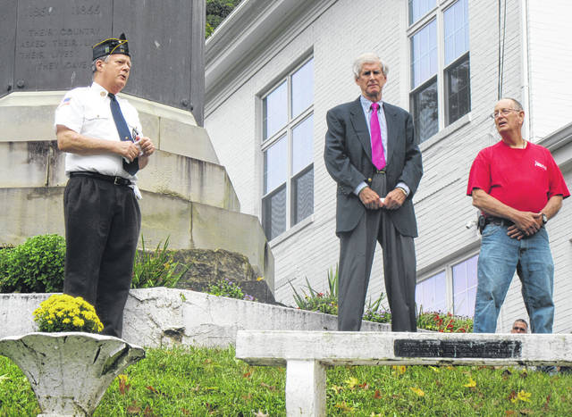 Steve VanMeter (left), Carson Crow (center) and George Korn (right) spoke during the Lifeline of Ohio flag raising on Thursday at the Meigs County Courthouse.