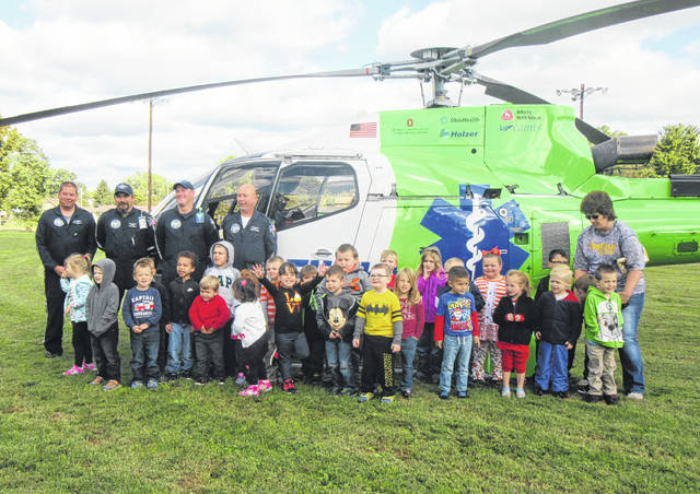 Preschool students from Carleton School are pictured with MedFlight as part of Safety Day on Friday.