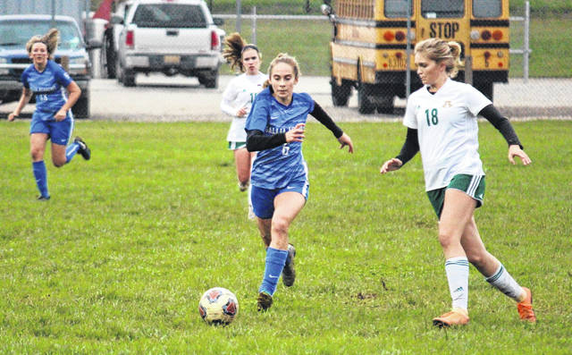 Gallia Academy sophomore Sarah Watts (6) races past an Athens defender, during the Blue Angels' 1-0 setback on Tuesday in Centenary, Ohio.