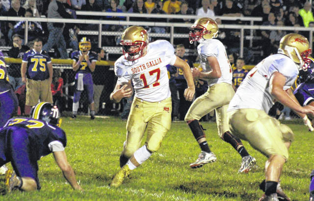 South Gallia's Gavin Bevan (17) carries the ball up the middle, during the Rebels' setback on Sept. 28 in Racine, Ohio.