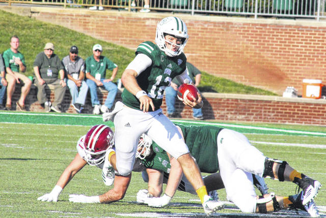 Ohio University junior Nathan Rourke (12) scrambles for a gain, during the Bobcats' 58-42 victory over non-conference guest UMass, on Saturday at Peden Stadium in Athens, Ohio.