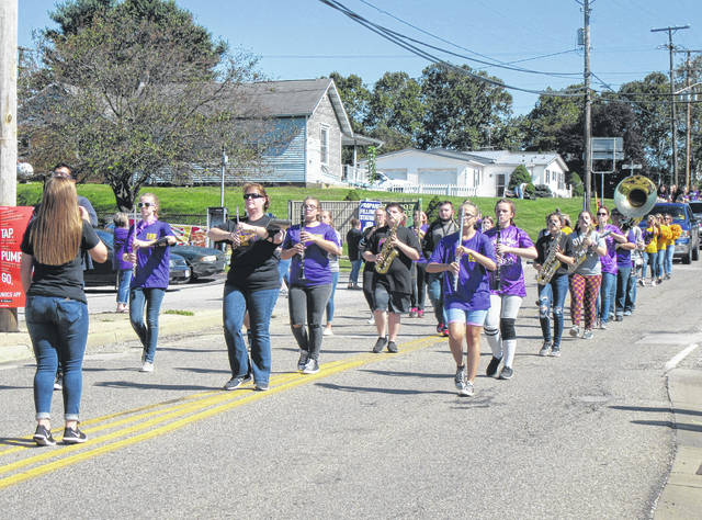 The Southern Marching Band, along with alumni band members, march in the Homecoming Parade.