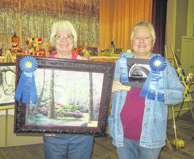 Rhojean McClure and Jennifer Harrison received Best of Show honors for their respective entries.