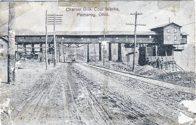 "This post card photo from 1911, from the collection of Marge Reuter, shows the Charter Oak Coal Works in Pomeroy. According to the notes on the back, the man and boy pictured on the far right of the photo are Mike Bentz and ""Pa Hannahs."" The coal works operated until around 1950 in Pomeroy."