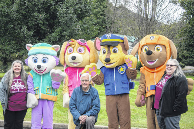 Representatives from the Point Pleasant River Museum and Learning Center are pictured with the Paw Patrol characters during the recent event at Farmers Bank in Point Pleasant.