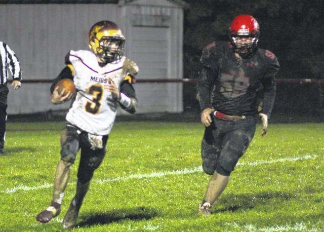 Meigs senior Cole Adams (3) breaks away from an Alexander defender during Friday night's Week 10 TVC Ohio football contest in Albany, Ohio.