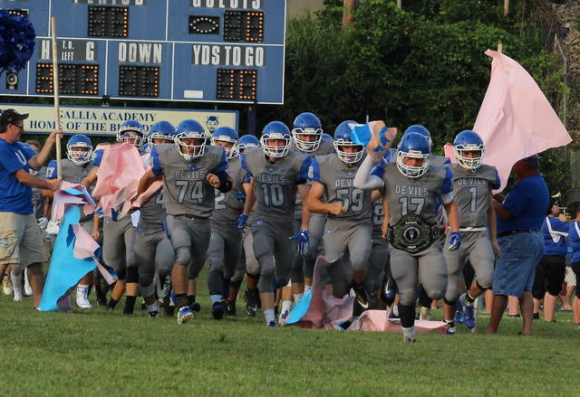 Members of the Gallia Academy football team take the field for the first time in a Week 1 contest against Meigs at Memorial Field. The Blue Devils start the second season at home this Saturday night when they face Newark Licking Valley in a Division IV, Region 15 playoff game at 7 p.m.