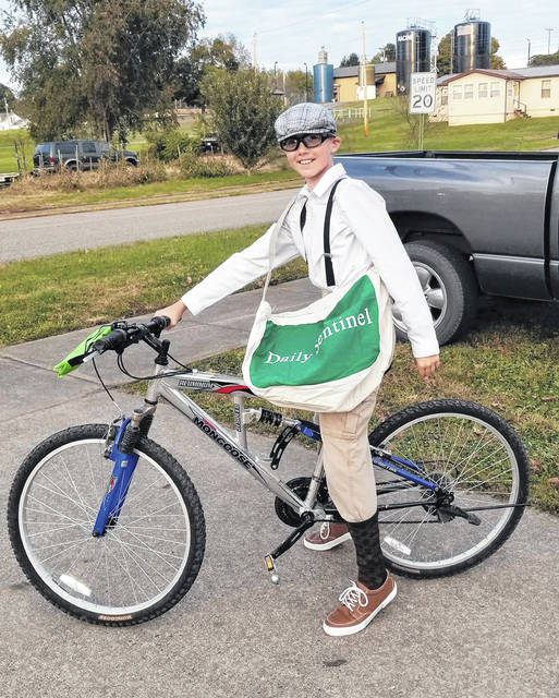 Trick or Treat in many areas in Meigs County took place last week, with kids of all ages dressing in costumes as they collected candy and other treats from local residents and businesses. The Daily Sentinel will be running photos submitted from around the area in this week's print editions and online at mydailysentinel.com. Here, Landen Woods dresses as a newspaper delivery person for Racine's Trick or Treat.