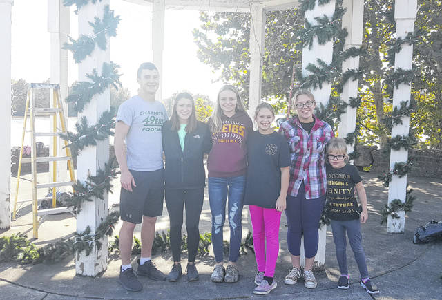 A group of volunteers organized by George and Nelle Wright worked to decorate the gazebo on the parking lot Tuesday afternoon. Pictured are (from left) Zach Bartrum, Lydia Edwards, Shalynn Mitchell, Phoebe Rife, Halo Rife and Olivia Rife.