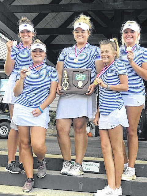 Members of the Gallia Academy girls golf team accept the trophy following their Division II Southeast District championship on Tuesday in Circleville, Ohio.