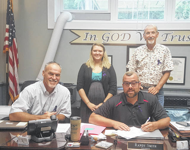 Victim Advocate Alexis Schwab is pictured with the Meigs County Commissioners during Thursday's meeting in which the commissioners approved a proclamation in recognition of Domestic Violence Awareness Month.