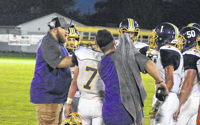 Southern head football coach Cassady Willford (left) talks to his team during a break in the action in the Tornadoes' shut out win on Sept. 7 in Mason, W.Va.