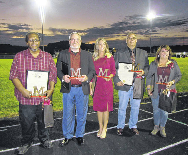 Distinguished Alumni and Service Awards were presented by the Meigs Local Alumni Association before Friday's Homecoming football game. Pictured are honorees Phillip Moon, Gary Coleman, Jillian Wilt-Kranyik, Dave Deem and Jamie Deem.