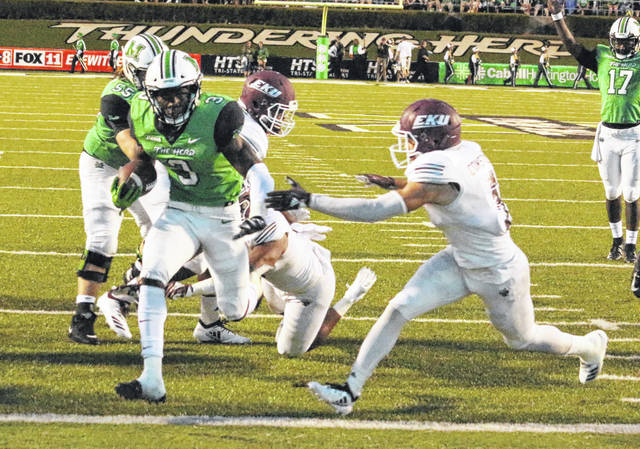 Marshall running back Tyler King scampers into the end zone for a score during a Sept. 8 football contest against Eastern Kentucky at Joan C. Edwards Stadium in Huntington, W.Va.