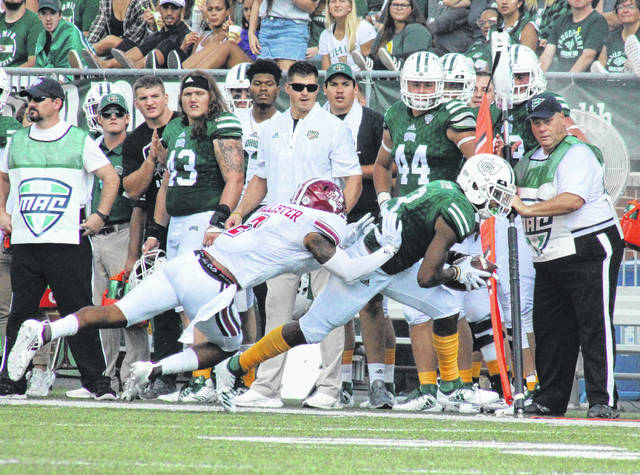 Ohio sophomore Cameron Odom (3) slips past a UMass defender for a first down, during the Bobcats' non-conference victory on Sept. 29 in Athens, Ohio.
