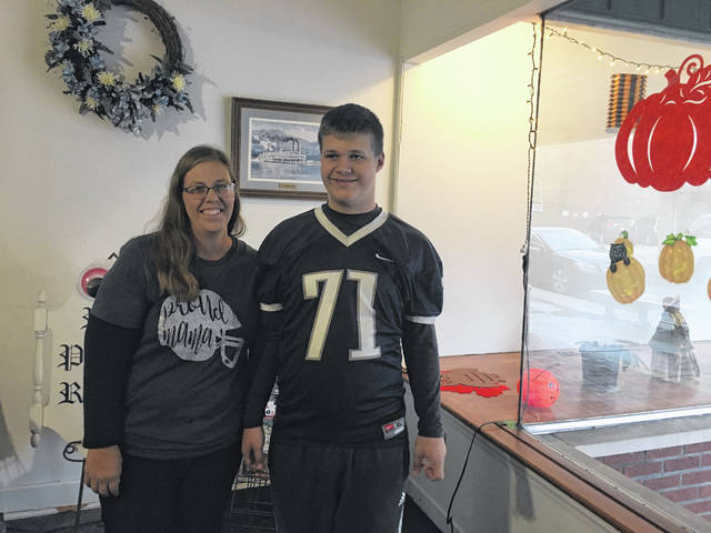 Hannan freshman student and football player Nathaniel Wilson pictured with his mother Danielle Wilson.