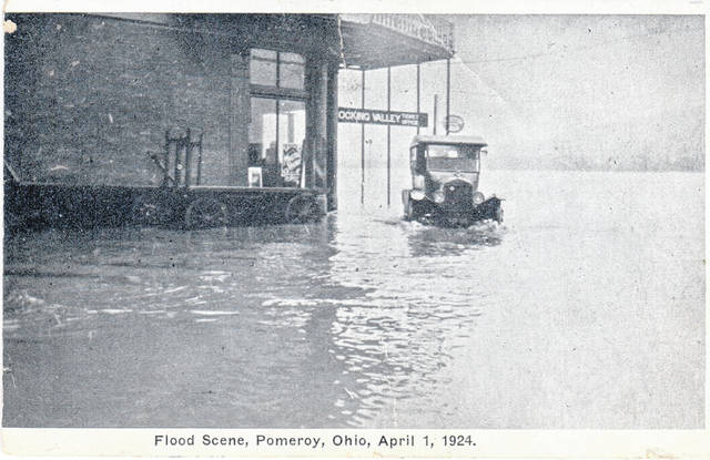 This postcard photo provided by Marge Reuter shows a Model T sitting in flood waters along Main Street in Pomeroy near the Hocking Valley Railroad Ticket Office. The date on the bottom of the postcard reads April 1, 1924.