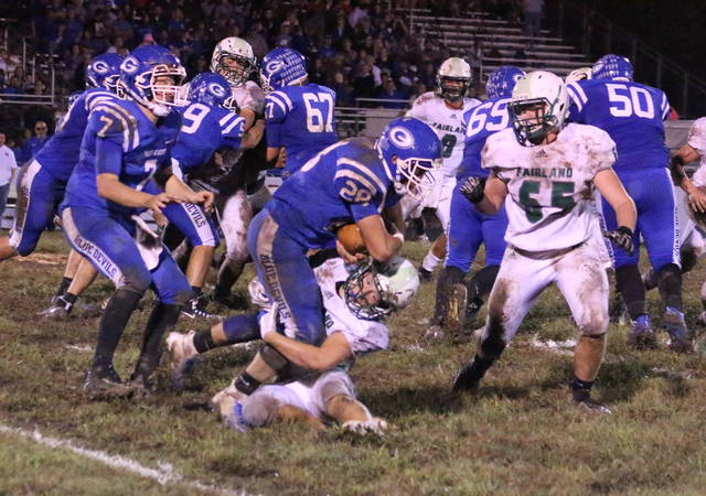 Gallia Academy running back Lane Pullins (28) runs over a Fairland defender during a Week 6 football game at Memorial Field in Gallipolis, Ohio. The Blue Devils will host Newark Licking Valley on Saturday in the opening round of the Division IV, Region 15 playoffs at 7 p.m.