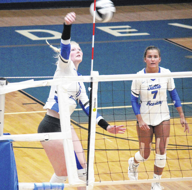 GAHS senior Ashton Webb (left) spikes the ball after a set from junior Peri Martin (7), during the Blue Angels' straight games win over Portsmouth on Sept. 27 in Centenary, Ohio.