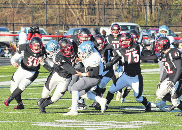 Point Pleasant defenders Nick Parsons (42) and Ryan Duff (75) chase down Mingo Central's Daylin Goad (3) for a tackle during Saturday's Class AA playoff opener at OVB Field in Point Pleasant, W.Va.