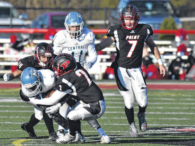 Point Pleasant defenders Nick Leport (14) and Josh Wamsley (2) bring down a Mingo Central ball carrier during a Class AA opening round playoff contest on Nov. 10 at OVB Field in Point Pleasant, W.Va.