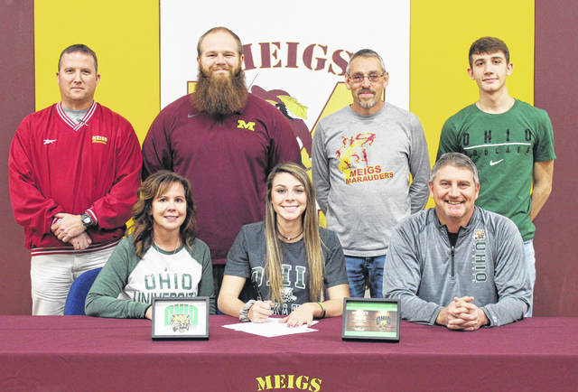 On Wednesday at Meigs High School, senior Kassidy Betzing signed her National Letter of Intent to join the Ohio University women's track and field team. Sitting in the front row, from left, are Kim Betzing, Kassidy Betzing and Cary Betzing. Standing in the back row are Meigs athletic director Kevin Musser, MHS assistant track coach Tyler Brothers, MHS track coach Mike Kennedy, and Cole Betzing.