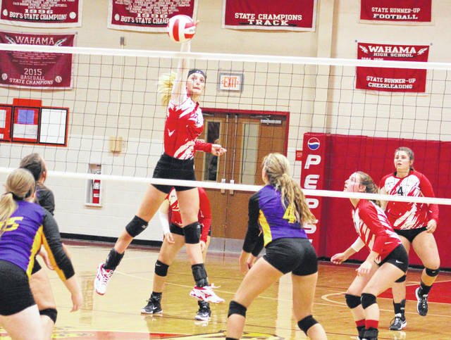 Wahama sophomore Emma Gibbs (7) hits a spike attempt during a Sept. 18 volleyball contest against Southern at Gary Clark Court in Mason, W.Va.