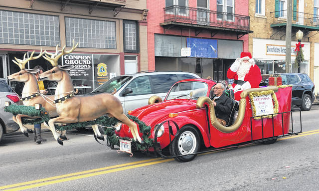 Santa made his way down Main Street as part of the parade before visiting with children at Peoples Bank in Pomeroy on Sunday.