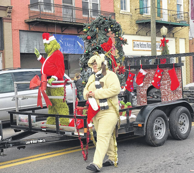 Santa wasn't the only one in a red suit for the parade as The Grinch also made an appearance.