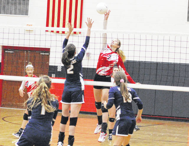 Wahama sophomore Emma Gibbs (7) hits a spike attempt during an Oct. 16 volleyball contest against Cross Lanes Christian at Point Pleasant High School in Point Pleasant, W.Va.