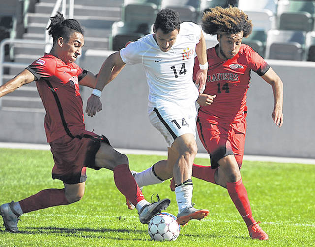 Rio Grande's Nicolas Cam Orellana splits a pair of Southern Oregon defenders during Monday's second round game in the NAIA Men's Soccer National Championship at Orange County Great Park in Irvine, Calif. Orellana scored both goals in the RedStorm's 2-0 win over the Raiders.