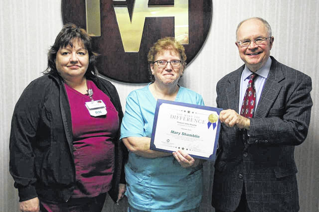 Pictured at center is Pleasant Valley Hospital Employee of the Month Mary Shamblin, along with Carrie Wright, ICU manager, and Glen Washington, FACHE, PVH CEO.