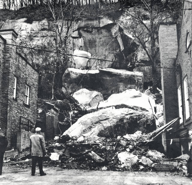 Photos dated Dec. 2, 1971, from the collection of Bob Graham show a large rock fall which impacted the parking and sorting areas of the Pomeroy Post Office on Second Street in Pomeroy. The first photos shows the size of the rock fall and the debris left behind by it looking toward the hillside from Second Street. In the second photo, Joe Struble continues to sort the mail among the damage caused by a rockfall. Graham's photos, including the ones here, can be seen at the Meigs Museum and on the Miegs County Library website.