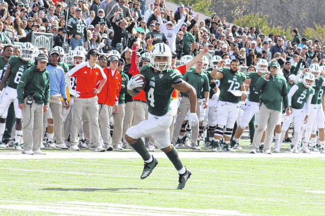 Ohio senior Papi White (4) breaks a touchdown run, during the Bobcats' victory over Bowling Green on Oct. 20 in Athens, Ohio.
