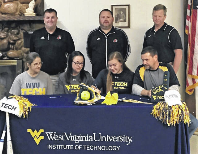 Wahama senior Tanner King, seated second from right, signed a letter of intent to play softball at West Virginia Tech on Nov. 14 at the Letart Community Building. Tanner — who spent her first three years of high school at Point Pleasant — is joined by her mother Paula King, WVU Tech head softball coach Amber Affholter, and father Brian King at the table. Standing in back are PPHS athletic director Kent Price, PPHS softball coach James Higginbotham, and Jodie Roush.