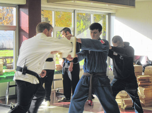 Martial Arts students and instructors from Bitanga's Martial Arts Center in Middleport broke hundreds of boards this weekend to raise money for the Meigs County Council on Aging's Auditorium renovation.
