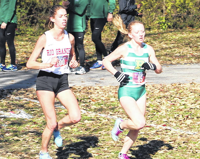 Rio Grande's Lucy Williams, left, finished fourth overall and earned a spot in the upcoming NAIA Women's Cross Country National Championship during Saturday's River States Conference Championship at Yellow Creek Park in Owensboro, Ky.
